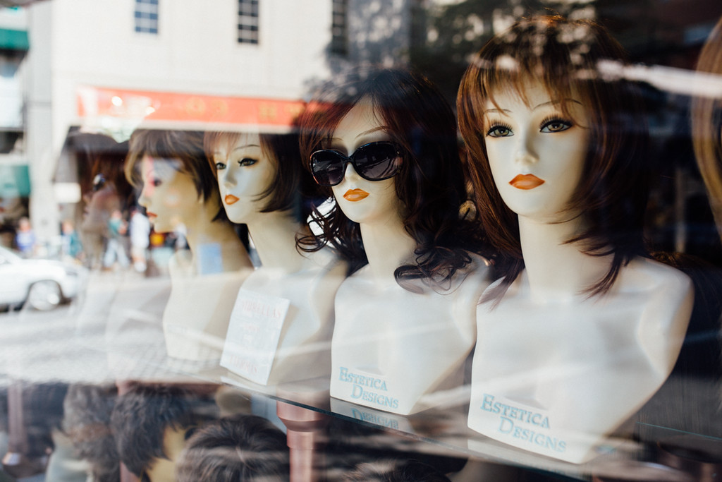 photo of manequin heads in a window by Laura Beth Davidson